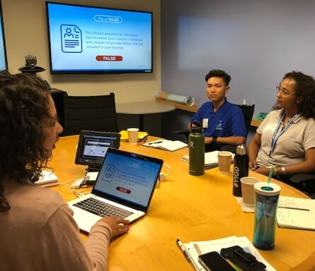 Young staff with computers have a working partnership with Disney